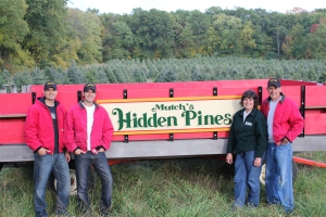 Family trees: When not at his practice, Dr. Peter Mutch (at far right), spends his time running Mutch's Hidden Pines tree far with his wife Nancy (third from left) and their sons, (at left) Andy Mutch and Dr. Nate Mutch.