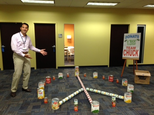 "CAPTION: Benco Dental Managing Partner Chuck Cohen presents the CenterPoint Design team's ""peaceful demonstration"" for the United Way Food Drive."