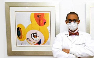 (Courtesy Ebony.com) In a photo featured in Ebony magazine, Dr. Lee Gause is shown with Takashi Murakami print as publicity for a recent article about his creative dental charity.  Read more at EBONY http://www.ebony.com/entertainment-culture/celeb-dentist-uses-art-to-provide-dental-work-421#ixzz37qkZ0WxA  Follow us: @EbonyMag on Twitter | EbonyMag on Facebook