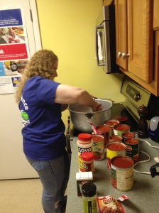 Benco Dental Associate Kim Egroff whips a batch of chili for dinner's main course for residents at Ruth's Place.