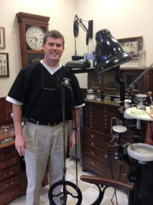 Third-generation Alabama dentist, Dr. H. Paul Hufham III, with his grandfather's dental equipment, on display for all of his patients in Dothan.