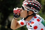 French cyclist Pierre Rolland drank a soda while riding in the 2013 Tour de France.