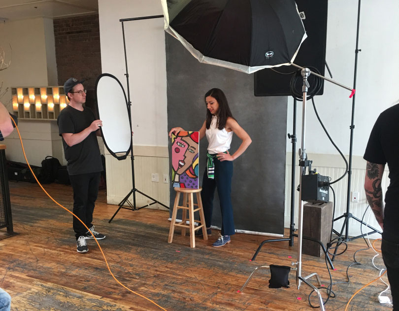 Image of Courtney Lavigne in Incisal Edge 40 Under 40 photo shoot with her artwork.
